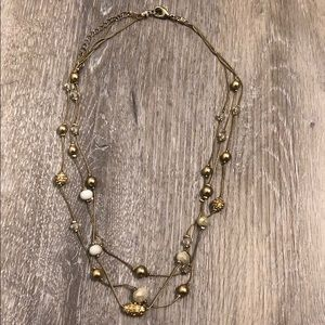 Gold three tiered beaded necklace